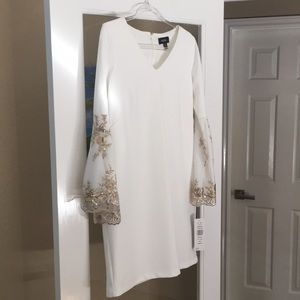 Off-white dress with flared arms/gold accents